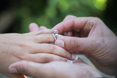 Placing wedding ring on finger Royalty Free Stock Image
