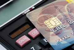 Plactic card over business culculator Royalty Free Stock Photos