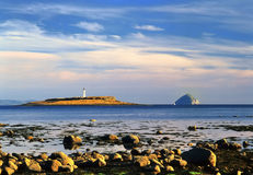 Pladda and Ailsa Craig, from Arran, Scotland. Seen from the south coast of Arran island, in the Firth of Clyde, are the isles of Pladda on the left and Ailsa stock image
