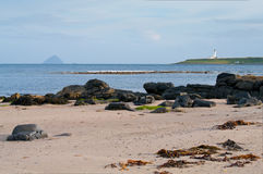 Pladda Island and Ailsa Craig. Viewed from Kildonan beach on the Isle of Arran, Scotland Stock Images
