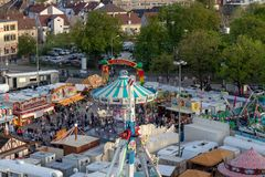Plaerrer, Augsburg Germany, APRIL 22, 2019: view out of the ferris wheel over the Augsburger Plaerrer. Swabia biggest funfair. Plaerrer, Augsburg Germany, APRIL stock photography