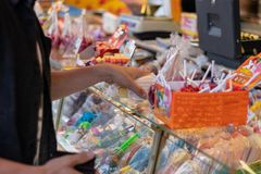 Plaerrer, Augsburg Germany, APRIL 22, 2019: young man buying candy on the a funfair. Plaerrer, Augsburg Germany, APRIL 22, 2019: young man buying candy on the a royalty free stock image