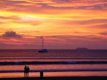 Plage au coucher du soleil Photographie stock