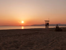Plage au coucher du soleil Photo stock