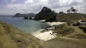 Plage blanche de sable dans Bali Indonésie Photographie stock libre de droits