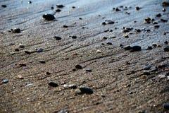 Plage de bord de mer de caillou de sable Photographie stock
