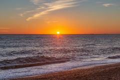 Plage de Brighton au coucher du soleil photographie stock libre de droits