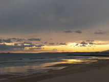 Plage de Caparica au coucher du soleil Photo libre de droits