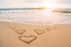 Plage de coeur de soleil d'amour Images libres de droits