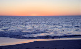 Plage de coucher du soleil photo stock