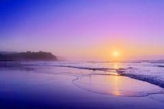 Plage de Sopelana au coucher du soleil Image stock