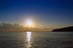 Plage et coucher du soleil Photographie stock