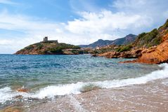 Plage at Girolata. View of Girolata castle and bay taken from the sea level Royalty Free Stock Photo