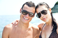 Plage heureuse de couples Photo libre de droits