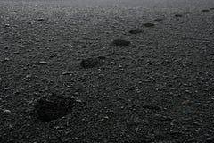 Plage noire Photo stock