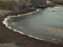 Plage noire de sable Image stock