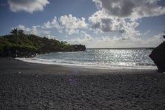 Plage noire de sable Photographie stock libre de droits