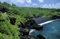 Plage noire de sable, Maui Photos stock