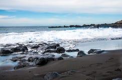 Plage volcanique de sable de noir d'arène de La de Playa Images libres de droits
