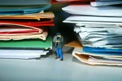 Plagiarism. Man standing between stolen work stock photos