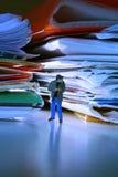 Plagiarism. Man standing between stolen work Stock Image