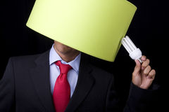 Plagiarism. Businessman holding a lamp (it's not his idea stock images