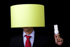 Plagiarism. Businessman holding a lamp (it's not his idea royalty free stock images