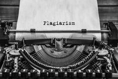 Plagiarism, copyright written. Close it. printed on a sheet of paper. Plagiarism, Copyright printed on an old typewriter. Black retro vintage aged typewriter stock photography