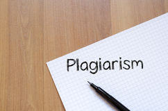 Plagiarism write on notebook. Plagiarism text concept write on notebook with pen stock photos