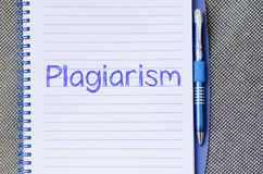 Plagiarism write on notebook. Plagiarism text concept write on notebook with pen stock photo