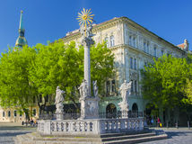 Plague Column at Fish Square in Bratislava, Slovakia. Plague Column at Rybne Namestie Fish Square in Bratislava, Slovakia at sunny spring day Stock Photography