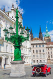 Plague Column of the Holy Trinity and red old car Royalty Free Stock Image