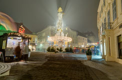 Plague column illuminated for Christmas, Baden, Austria Stock Photos