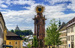 Plague column in the Trinity Square and new castle, Banska Stiavnica, Slovakia Stock Images