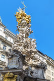 Plague Column in Vienna. Plague Column (Pestsaule)  is a Holy Trinity column located on the Graben street in Vienna, Austria. Erected after the Great Plague Royalty Free Stock Image