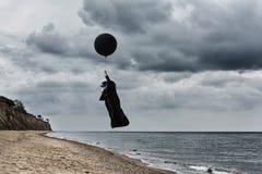Plague doctor fly in a hot air balloon .