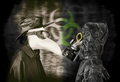 Plague doctor and man in gas mask. Stock Photo