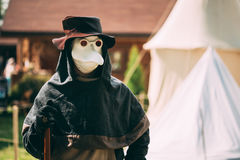 Plague doctor - participant of festival of medieval culture Royalty Free Stock Photography