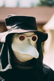 Plague doctor - participant of festival of Royalty Free Stock Image