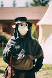 Plague doctor - participant of festival of Stock Photo