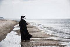 Plague doctor in seaside.