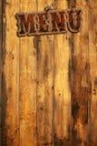 Plague menu nailed on wood wall Stock Photo