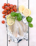 Plaice fillet. Fresh plaice fillet on wooden ground Stock Photography