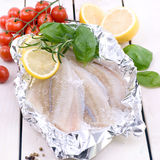 Plaice fillet. Fresh plaice fillet on wooden ground Royalty Free Stock Photo