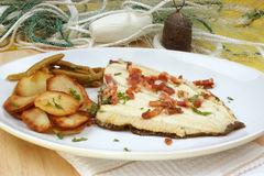 Plaice with fried potato and organic beans Stock Images