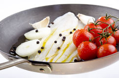 Plaice with tomato and onion Stock Photo