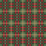 Plaid background. Pattern swatch reds and green some frayed edges on the stiching Stock Image