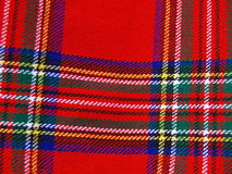 Plaid background. A closeup view of a bright, colorful plaid or tartan fabric Stock Photos