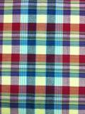 Plaid-Baumwollgewebe des bunten Hintergrundes und der abstrakten Beschaffenheit Lizenzfreies Stockfoto