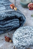 Plaid blanket. Gray plaid blanket with a stone and autumn leaves Royalty Free Stock Images